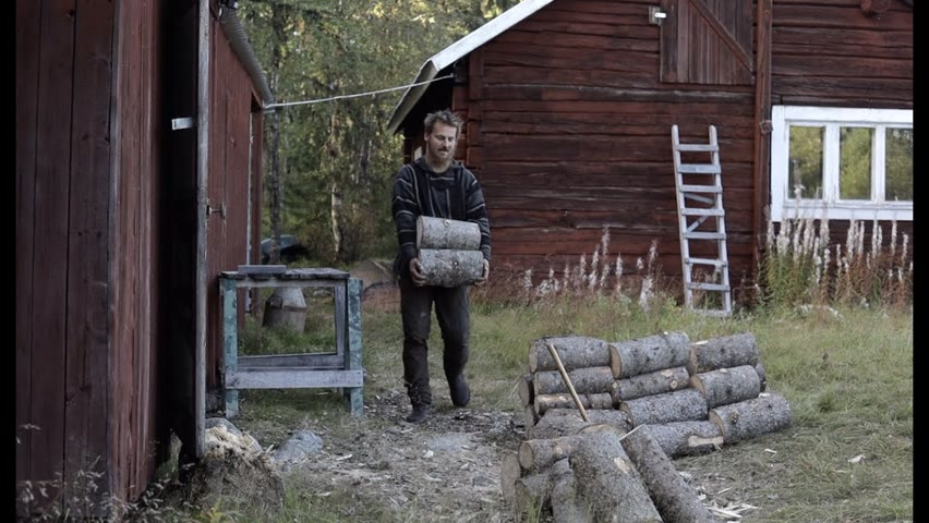 Making fire wood  - log cabin in Sweden, axe and chain saw