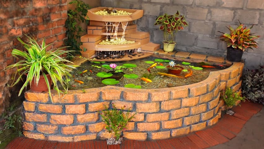 How to Transform Your Family Garden Into a Beautiful Corner With Waterfall Aquarium