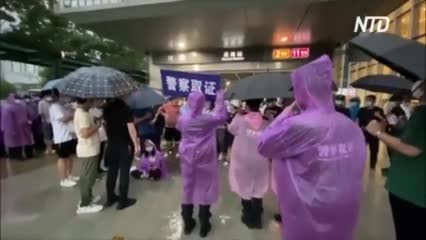 У штаб-квартиры китайского девелопера Evergrande протестуют инвесторы