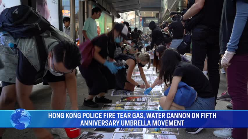 HONG KONG POLICE FIRE TEAR GAS, WATER CANNON ON FIFTH ANNIVERSARY UMBRELLA MOVEMENT