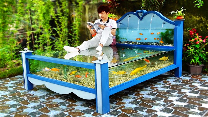 A masterpiece made from cement and glass! beautiful outdoor aquarium bed