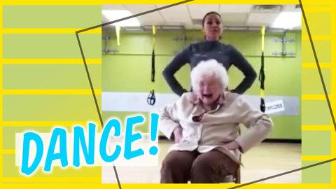 Senior Citizen Performs Dance Routine in Chair