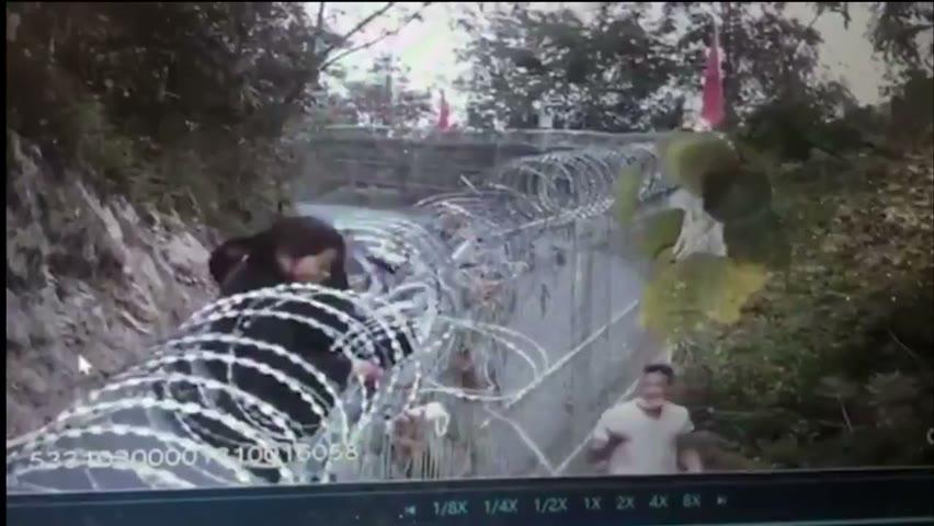 邊境牆偷渡监控视频爆出。雲南 #中緬邊界,沿瑞麗江高黎貢山修建鐵絲網,綿延500公里。【投稿acmedia2015@gmail.com】