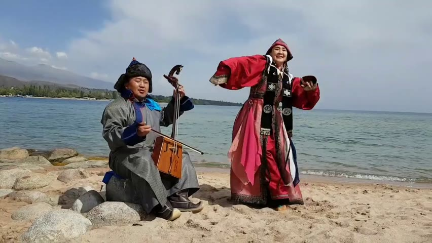 At the Issyk kul lake in Kyrgyzstan with the honorary dancer Odontuya Sh of Mongolia