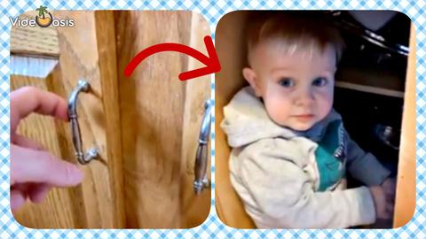 Little boy watches TV inside closed kitchen cabinet|VideOasis