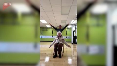 Senior Citizen Performs Dance Routine in Chair.mov
