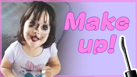Little Girl Paints Face With Mascara