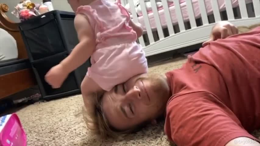 This Father Lets His Daughter Sit on His Head
