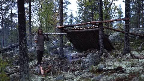 Bushcraft trip - shelter building, boat down river, reindeer skin, meat [lean-to part 1]