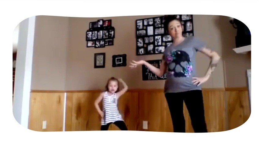 Little Girl and Pregnant Mom Dance Together